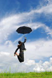 Business umbrella woman jumping  blue sky Royalty Free Stock Photography