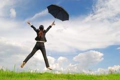 Business umbrella woman jumping to blue sky Stock Photos