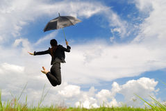 Business umbrella woman jumping to blue sky Stock Photo