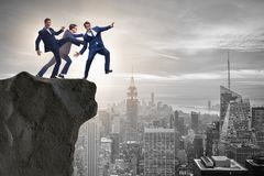 The business unethical competition concept with businessmen. Business unethical competition concept with businessmen Stock Photos
