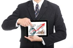 Business used finger touch growing graph Stock Photo
