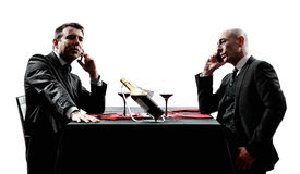 Business using smartphones dinner silhouettes Stock Image