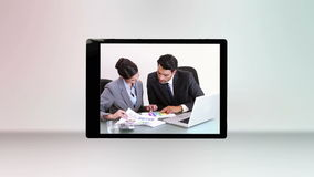 Business videos on a tablet computer Stock Photo