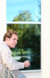 Business view. Young man leans on railing Royalty Free Stock Images