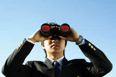 Business vision. Businessman looking through binoculars, can be used for vision/prospects metaphor Royalty Free Stock Image
