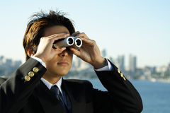 Business vision. Businessman with binoculars, can be used for business vision/prospect metaphor stock image