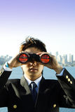 Business vision. Businessman looking through binoculars, can be used as vision/prospect metaphor Stock Photos