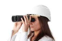 Business vision. Concept, enginer woman looking throught binoculars, isolated on white Stock Image