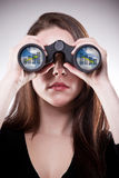 Business vision. A businesswoman looking through binoculars, seeing conflicting trends in earnings prediction, can be used for business vision or business royalty free stock images