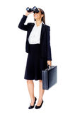 Business vision. Concept with businesswoman looking through binoculars while wearing a suit and with briefcase isolated on white royalty free stock photos