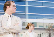 Business vision. Two people standing looking to their left in front of office building Royalty Free Stock Photo