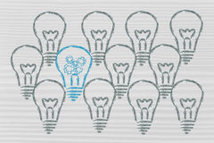 Business vision: be unique, not average. Average vs. uniqueness: one unique lightbulb in a crowd of clones Royalty Free Stock Images