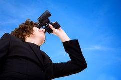 Business vision - businesswoman over a blue sky Royalty Free Stock Photo