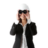 Business vision concept. Enginer woman looking throught binoculars, isolated on white Royalty Free Stock Image