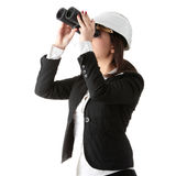 Business vision concept. Enginer woman looking throught binoculars, isolated on white Royalty Free Stock Photos
