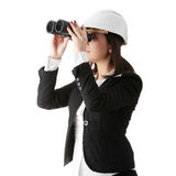 Business vision concept. Engineer woman looking throught binoculars, isolated on white Stock Photography