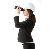 Business vision concept. Engineer woman looking throught binoculars, isolated on white Royalty Free Stock Photography