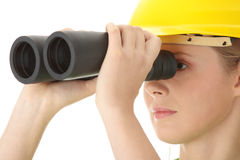 Business vision concept. Engineer woman looking through binoculars, isolated on white Royalty Free Stock Images