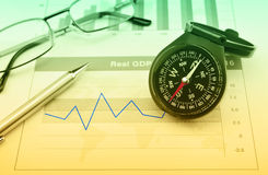 Business vision concept. Compass with pen and glasses on growth financial graph and chart, Business vision concept stock image