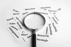 Business vision concept. Magnifying glass and lot of other business concept words paper is showing the concept of business vision concept. Blank space of Stock Photo