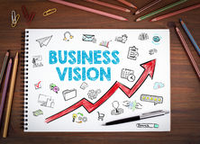 Business Vision Concept. Notebooks, pen and colored pencils on a wooden table.  Royalty Free Stock Photos
