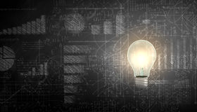 Business vision. Glowing light bulb with sketches at background Stock Photos