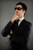 Business Vision. Image of a business man wearing sunglasses Stock Photography