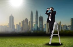 Business vision looking forword with binoculars Royalty Free Stock Image
