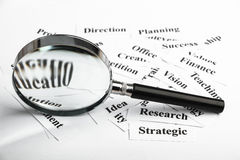 Business vision. Magnifying glass and lot of other business concept words paper is showing the concept of business vision Royalty Free Stock Image