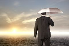 Business vision and strategy concept. With businessman holding umbrella royalty free stock photos