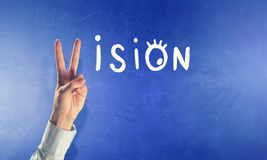 Business vision. Vision word with fingers instead of letter v Stock Images