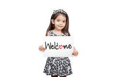 Business welcome concept, Cute girl holding a welcome sign stand stock images
