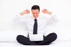 Business winner. Happy arm rising business man making winning posing Royalty Free Stock Images