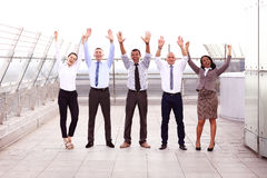 Business winners. Full length of group of happy young people in formal wear celebrating, keeping arms raised and. Business winners. Full length of group of happy Stock Photography