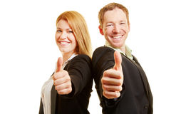Business winners holding thumbs up Stock Image