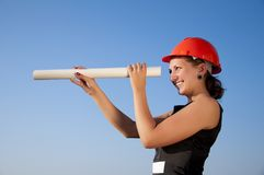 Business woman ��в construction plans Royalty Free Stock Photography