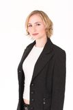 Business woman. With power suit and white top Stock Photography