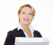 Business woman. Portrait of a successful smiling business woman over white background royalty free stock photography