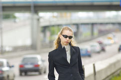 Business woman. Near the road stock photography