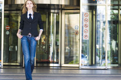 Business woman. Walkink out of office tower royalty free stock images