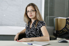 Business woman. Portrait of a contemporary business woman on the workplace stock images