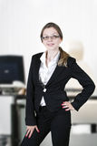 Business woman. Portrait of smiling business woman in cabinet stock photos