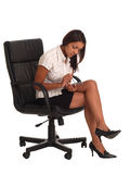 Business woman. Sat on an office chair with a pda computer Stock Photography