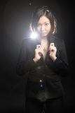 Business woman. Asian business woman in black suit, portrait with flare Royalty Free Stock Photography