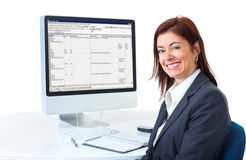 Business woman. Smiling business woman working with computer. Isolated over white background Royalty Free Stock Image