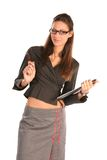 Business woman. Young beautiful woman holding folder and pencil, isolated on white Royalty Free Stock Photography