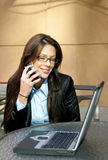 Business Woman. With cell and laptop stock photo