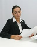 Business woman. Businesswoman reading in office stock photography