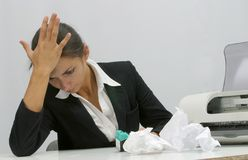 Business woman. Frustrated business woman is trying to install ink cartridge in printer stock photo
