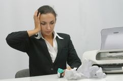 Business woman. Frustrated business woman is trying to install ink cartridge in printer stock photos